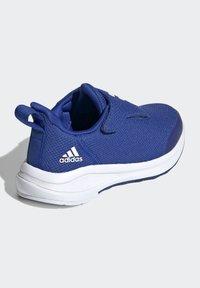 adidas Performance - FORTARUN RUNNING - Stabilty running shoes - blue - 4