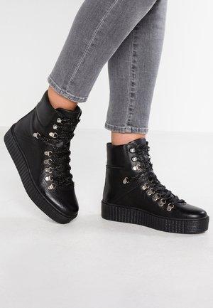 AGDA - Platform ankle boots - black