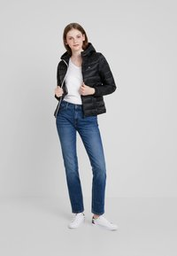 Tommy Jeans - QUILTED ZIP THRU - Light jacket - black - 1