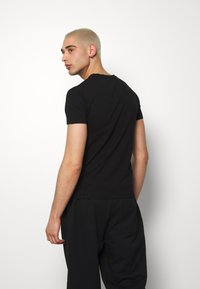 Volé la lumière - MULTI SKULL TSHIRT - T-shirt print - black - 2