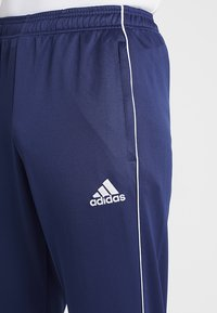 adidas Performance - CORE - Tracksuit bottoms - dark blue/white - 6