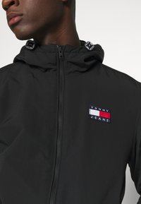 Tommy Jeans - PADDED JACKET - Light jacket - black - 6
