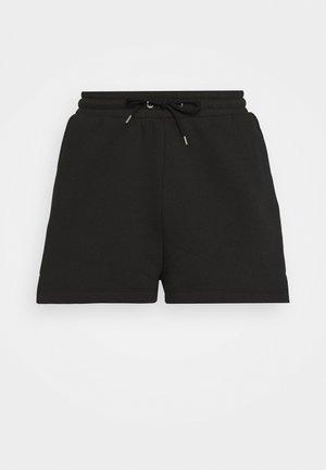 CLOEY - Tracksuit bottoms - black