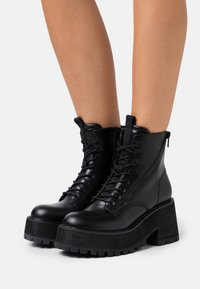 Tata Italia - Lace-up ankle boots - black - 0