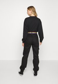 Missguided - PRIDE RAINBOW BELTED TROUSER - Cargo trousers - black - 2