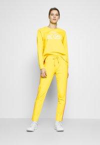 Bogner Fire + Ice - THEA - Spodnie treningowe - yellow - 1
