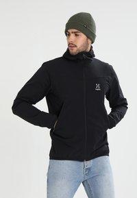 Haglöfs - NATRIX HOOD MEN - Soft shell jacket - true black - 0