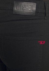 Diesel - D-STRUKT - Jeans Tapered Fit - black denim - 3