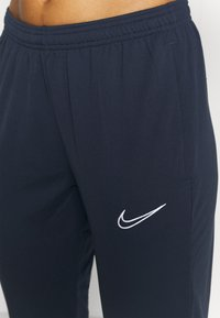 Nike Performance - PANT - Tracksuit bottoms - obsidian/white - 3