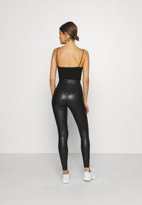 Topshop - WET LOOK - Leggings - Trousers - black - 2