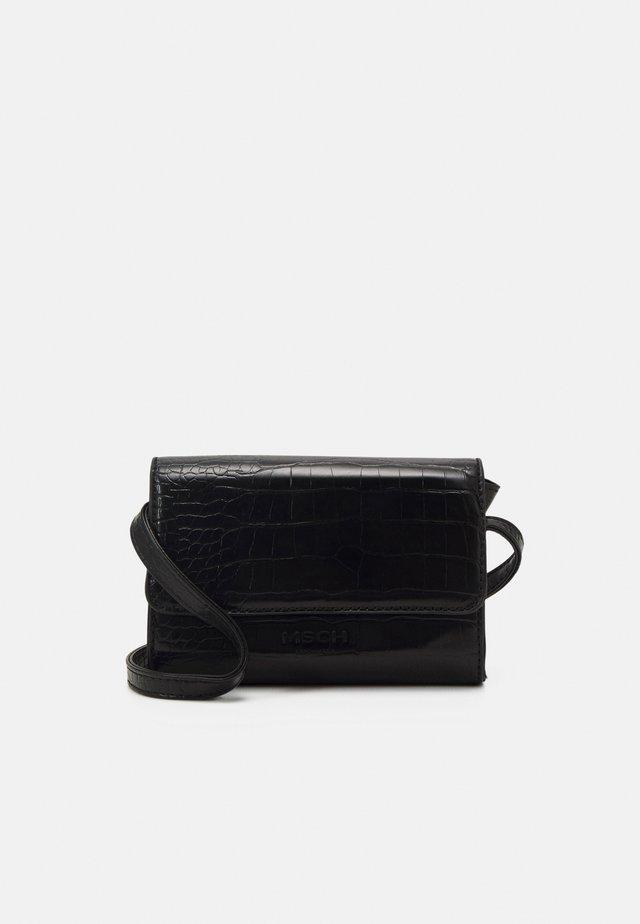 JACIA CROSSOVER BAG - Taška spříčným popruhem - black