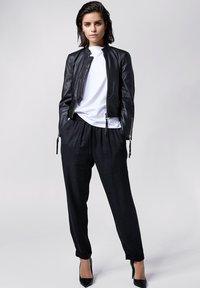 Tigha - Leather jacket - black - 1