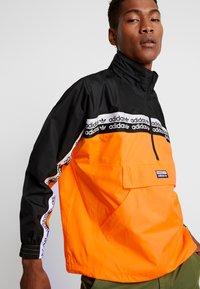 adidas Originals - REVEAL YOUR VOICE - Windbreakers - flash orange - 4