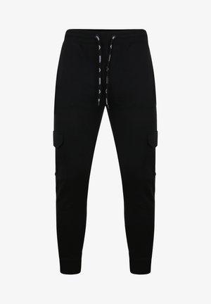 STEFAN - Tracksuit bottoms - black