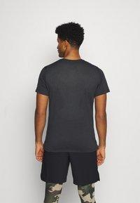 Nike Performance - BURNOUT - Print T-shirt - black/bright crimson - 2