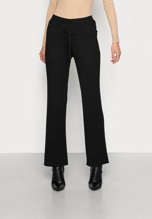 ARON PANT - Trousers - black