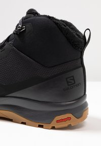 Salomon - OUTSNAP CSWP - Winter boots - black/ebony - 5