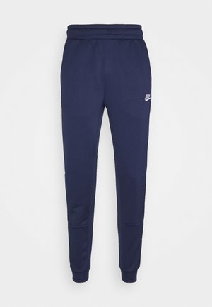 TRIBUTE - Tracksuit bottoms - midnight navy/white