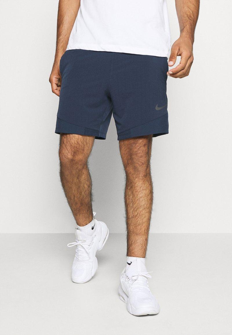 Nike Performance - FLEX - Pantalón corto de deporte - obsidian/black