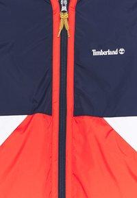 Timberland - HOODED WINDBREAKER - Light jacket - orange - 2