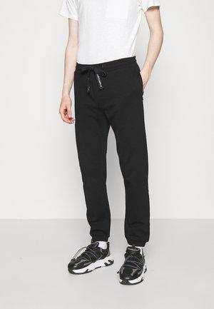 PANTALONE - Teplákové kalhoty - black