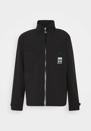 PUMA X TH CHORE JACKET - Summer jacket - black