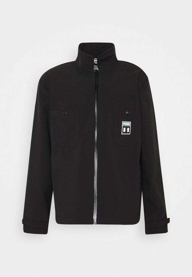PUMA X TH CHORE JACKET - Summer jacket - black