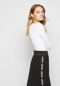 HUGO - NEEMA - Pouzdrová sukně - black - 3