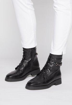 MELA - Lace-up ankle boots - black