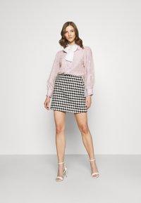 Sister Jane - PICK A PETAL BOW BLOUSE - Button-down blouse - pink - 1