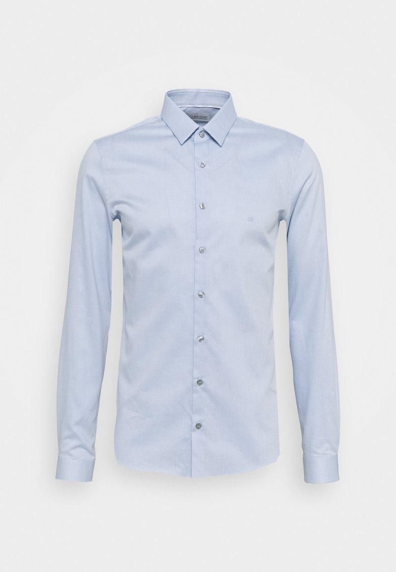 Calvin Klein Tailored - NATURAL STRETCH EXTRA SLIM SHIRT - Formal shirt - light blue