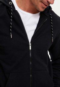 DeFacto - Zip-up hoodie - black - 3