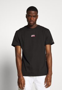 Tommy Jeans - SMALL CENTERED LOGO TEE - Print T-shirt - black - 0