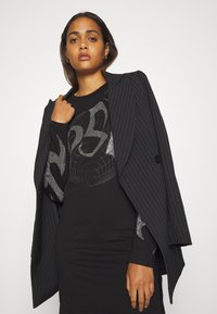 Diesel - T-ROSSINA T-SHIRT - Jersey dress - black - 3