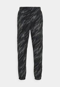 Nike Sportswear - PANT - Tracksuit bottoms - black/orange - 6
