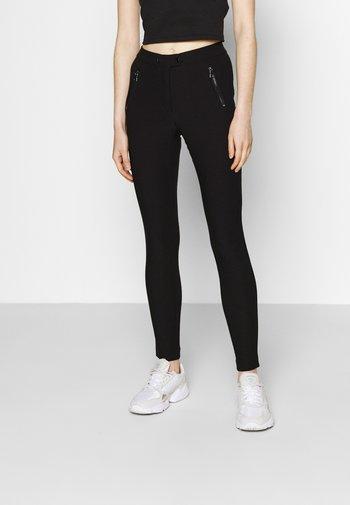 ONLJAMILA  - Leggings - Trousers - black