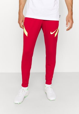 STRIKE PANT  - Pantalon de survêtement - gym red/bright crimson/volt