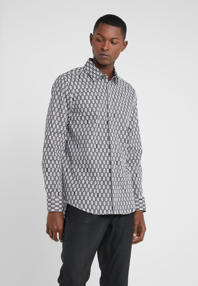 Camisa - razor blad