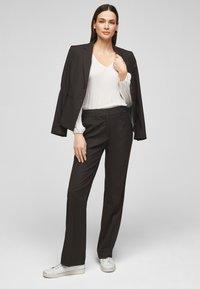 s.Oliver BLACK LABEL - Trousers - true black - 1