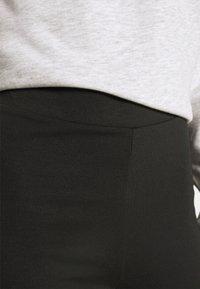 Monki - WILDA TROUSERS - Spodnie materiałowe - black - 5