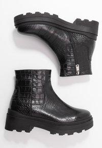Janet Sport - Kotníkové boty na platformě - miranda nero - 3