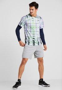 Nike Performance - LEGEND TEE NATURAL HIGH - T-Shirt print - ghost - 1