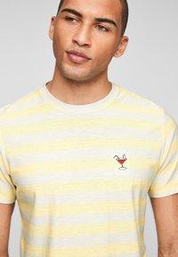s.Oliver - Print T-shirt - light yellow stripes - 4