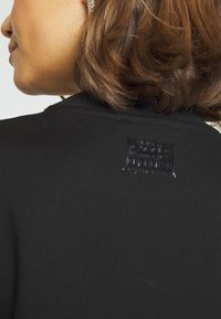 Diesel - EYESIE DRESS - Jersey dress - black - 4