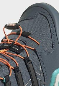 adidas Performance - TERREX SWIFT R2 HIKING SHOES - Hiking shoes - green - 8