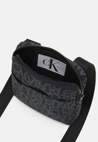 Calvin Klein Jeans - LOGO FLAT CROSS BODY BAG - Across body bag - black - 2