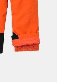 Ziener - ARISU UNISEX - Zimní kalhoty - neon orange - 3