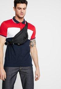 Fila - WAIST BAG SLIM - Bum bag - black - 1