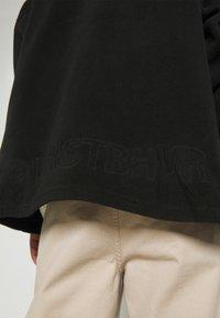 WRSTBHVR - GATY UNISEX - Fleece jacket - black - 5