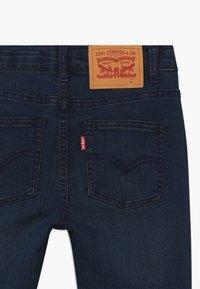 Levi's® - SKINNY TAPER - Skinny džíny - dark-blue denim - 3